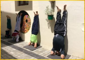 Family wall headstands